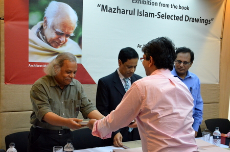 Nurur Rahman Khan presenting Muzharul Islam's book to Shamsul Wares